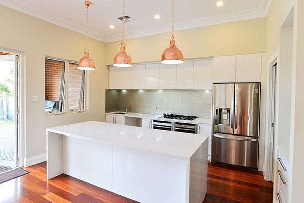 Quality kitchen renovation with timber flooring, pendant lights, island bench and awning windows