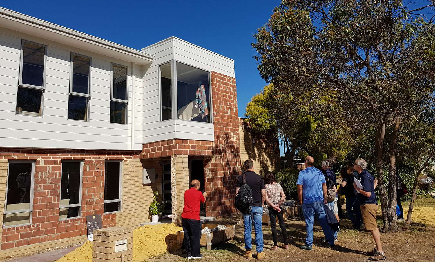 Home Base Owner-Builder course attendees on site