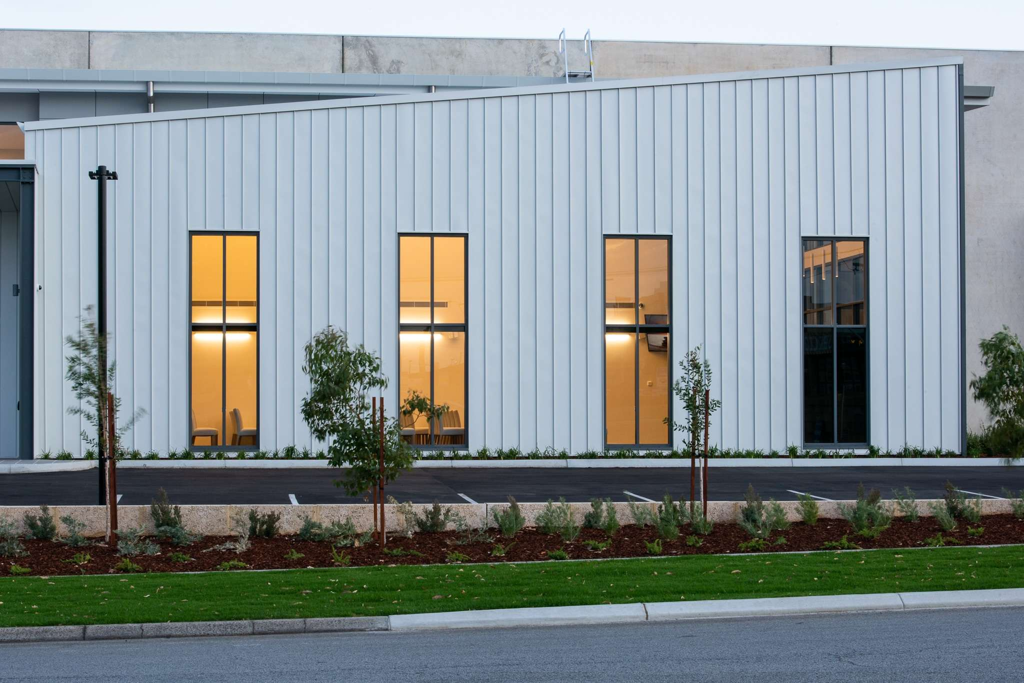 InvoCare Wangara. Street view of the windows used on this commercial project in Wangara. Products used include Capral AGS 400 series, 225 series doors, Artisan Bi-fold
