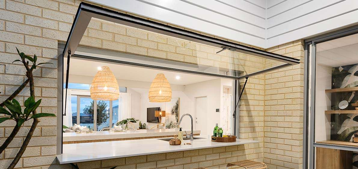 Awning Gas Strut Window by Jason Windows. It's pictured here being used as a servery window from the kitchen to the alfresco.